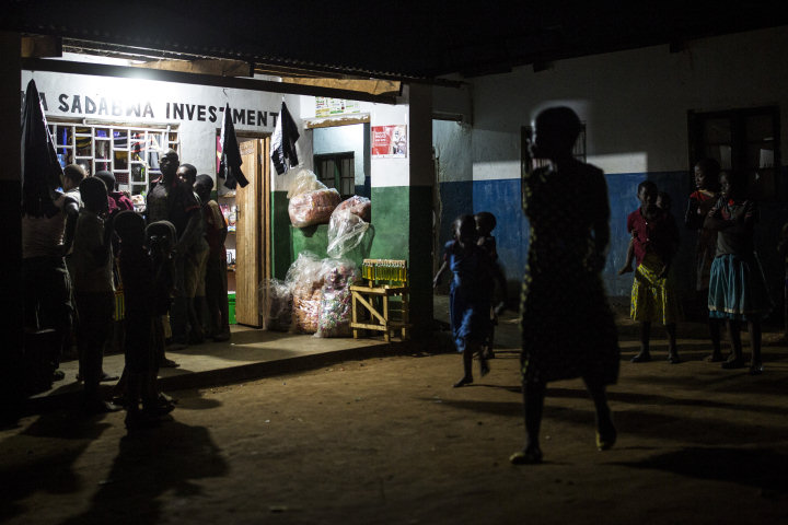 At night, Fabiyano's shop is a social hub for his village